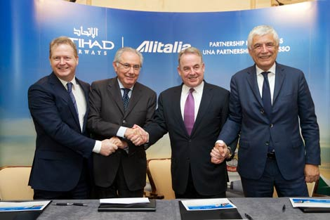 Etihad Airways' Chief Financial Officer, James Rigney; Alitalia Chairman, Roberto Colaninno; Etihad Airways' President and Chief Executive Officer, James Hogan; and Alitalia Chief Executive Officer Gabriele Del Torchio mark the official signing of the investment deal in Rome, Italy.