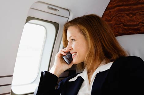 Woman on phone in plane