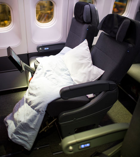 Business class seat with bedding
