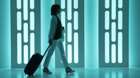 Businesswoman with trolley in a modern airport