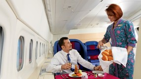 Malaysia_Airlines_inflight_meal_service_by_attendant