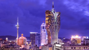 The Grand Lisboa in Macau, China, with Macau Tower in background