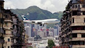 A Cathay Pacific B747 flies over Hong Kong - Credit: Daryl Chapman