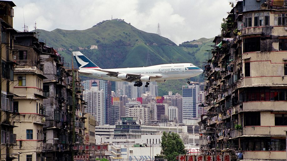 A Cathay Pacific B747 flies over Hong Kong - Credit: Daryl Chapman