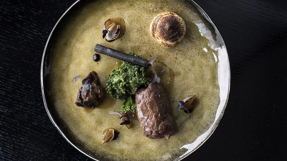 Peninsula Restaurant - Irish Rib Eye, Ox Cheek, Pickled Onion, Black Garlic, Salsify