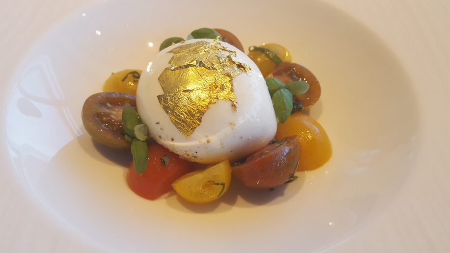 Fresh burrata, basil and gold leaf - Cathay Pacific and Tosca in-flight menu