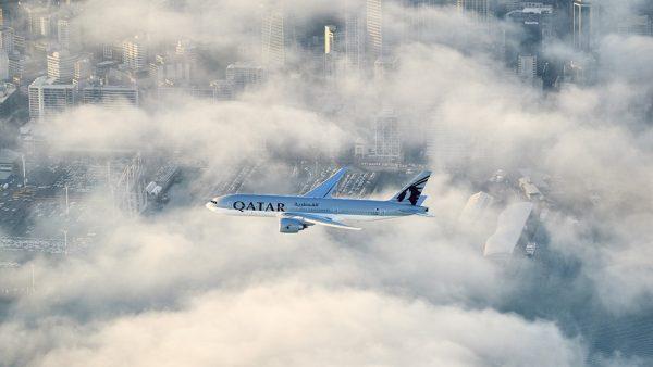 Qatar Airways' B777 flies over Auckland as the world's longest commercial flight