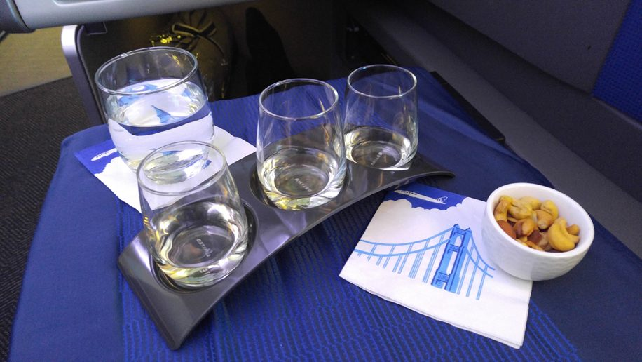 United B777-300ER Polaris Business wine tasting with nuts