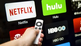 Canton, GA, USA - October 4, 2015 Netflix, hulu, and hbo subscription streaming video service accessed through a Apple tv and displayed on a hd tv. These application are paid services popular with cable cutters as an alternative to paying for cable.