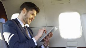 Man using tablet (SITA stock image)