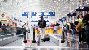 Passenger walking through Chicago O'Hare International Airport (iStock)