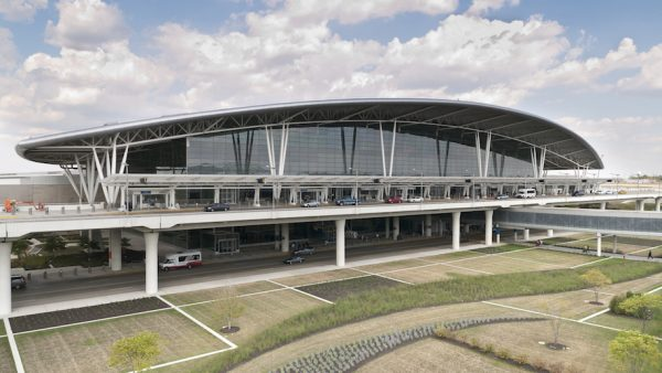 Indianapolis, United States - September 12, 2011: The Colonel H. Weir Cook Terminal is gracefully situated between the runways of Indianapolis International Airport. Passengers travel above sculpted grounds along the enclosed pedestrian bridge (right) that connects the terminal to the parking structure.