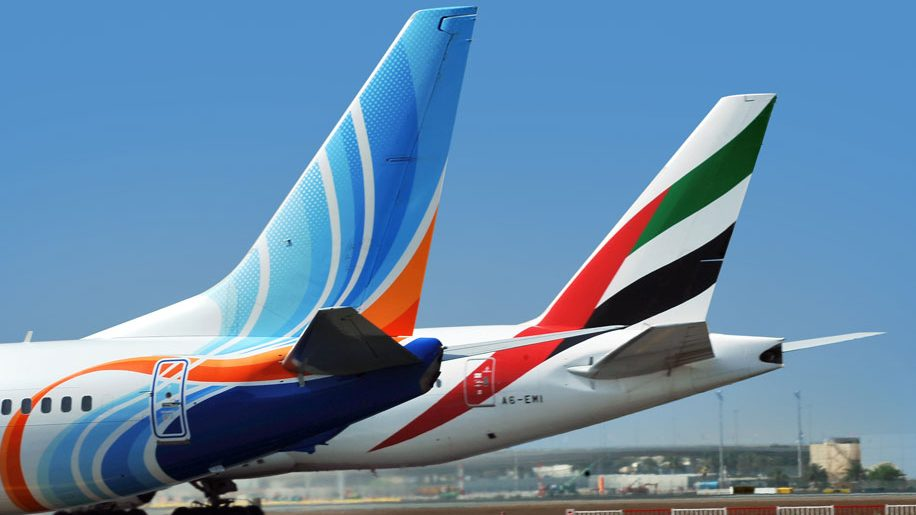 Tailfins of Emirates and Flydubai