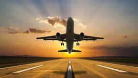Passenger airplane taking off at sunset (iStock)