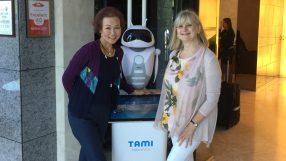 Doris Hui, General Manager of Dorsett Shanghai (left) with V Jr (centre), the 1st robot to be part of the hotel's guest service team.