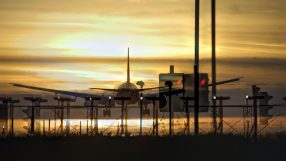 Airplane approaching the landing strip at sunset. Heathrow, London, UK.